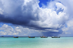 Beautiful tropical beach with cumulus storm cloud and pouring ra Stock Photo