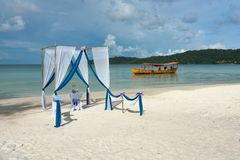 Beautiful tropical beach with decorated tent prepared for ceremony Stock Image
