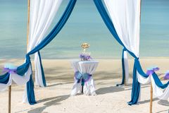 Beautiful tropical beach with decorated tent prepared for ceremony Stock Photography