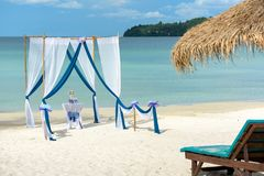Beautiful tropical beach with decorated tent prepared for ceremony Royalty Free Stock Photo
