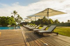 Beautiful tropical beach front hotel resort with swimming pool, stock photos