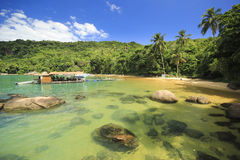 Beautiful tropical beach with green water and restaurant in it Stock Photography