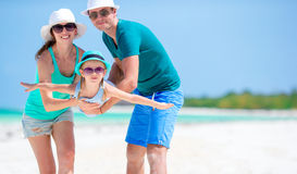 Beautiful tropical beach landscape with family enjoying summer vacation Royalty Free Stock Photo