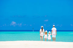Beautiful tropical beach landscape with family in Royalty Free Stock Photo