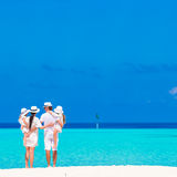 Beautiful tropical beach landscape with family in Stock Photos