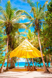 Beautiful tropical beach with palm trees, white sand, turquoise ocean water and blue sky Royalty Free Stock Image
