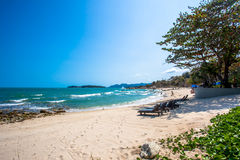 Beautiful tropical beach with trees and sunbeds. In Koh Samui Royalty Free Stock Images