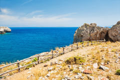 Beautiful tropical beach with turquoise water and cliffs. Royalty Free Stock Images