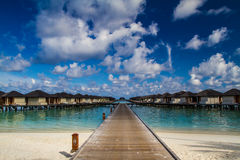 Beautiful tropical beach with water bungalows in Maldives Stock Image