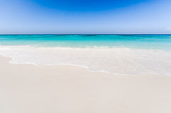 Beautiful tropical beach, white sand and blue sky background. Stock Image