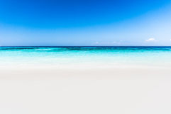 Beautiful tropical beach, white sand and blue sky background. Royalty Free Stock Photography