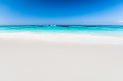 Beautiful tropical beach, white sand and blue sky background wit Royalty Free Stock Image