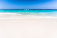 Beautiful tropical beach, white sand and blue sky background wit Stock Photos