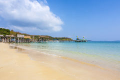 Beautiful tropical beach with wooden pier Stock Photo