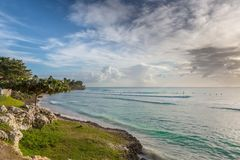 Beautiful Tropical Coast with Clear Water and Cloudy Sky Stock Images