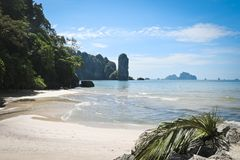 Beautiful tropical coast of Thailand overlooking the beach, azure sea and high steep cliffs, Krabi, Ao Nang stock photo