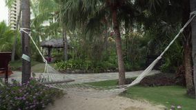 Beautiful tropical garden with hammock on site Resort Intime Sanya 5 stock footage video stock footage