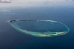 Beautiful tropical island arial view from seaplane at Maldives Stock Photo