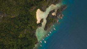 Beautiful tropical lagoon, aerial view. Tropical island. Tropical lagoon with turquoise water and white sand. Blue Lagoon with tourists and motor boats stock video footage