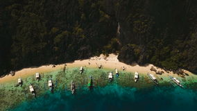 Beautiful tropical lagoon, aerial view. Tropical island. Tropical lagoon with turquoise water and white sand. Blue Lagoon with tourists and motor boats stock footage