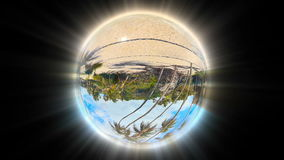 Beautiful Tropical Landscape seen through a Glass Globe, seamless loop stock footage