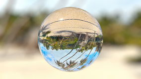 Beautiful Tropical Landscape seen through a Glass Orb, seamless loop stock video footage