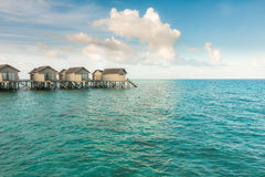 Beautiful tropical Maldives resort hotel with beach and blue wat Royalty Free Stock Photos