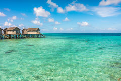 Beautiful tropical Maldives resort hotel with beach and blue wat Stock Photography