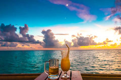 Beautiful tropical Maldives resort hotel with beach and blue wat Royalty Free Stock Images