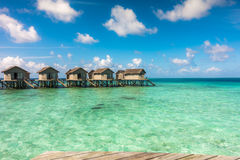 Beautiful tropical Maldives resort hotel with beach and blue wat Stock Photos