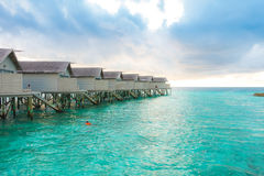 Beautiful tropical Maldives resort hotel with beach and blue wat Royalty Free Stock Image