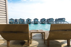 Beautiful tropical Maldives resort hotel with beach and blue wat Stock Images