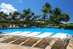 Beautiful tropical resort. Swimming pool in a tropical resort Royalty Free Stock Photos
