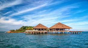 Beautiful tropical resort hotel and island with beach and sea on Stock Photography