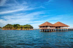Beautiful tropical resort hotel and island with beach and sea on Royalty Free Stock Photography