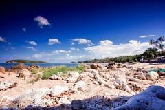 Beautiful tropical rocky beach with rocks on the Stock Photos