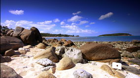 Beautiful tropical rocky beach with rocks on the stock video footage
