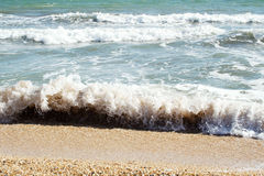 Sands beach and waves of crystal clear blue waters Stock Images