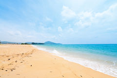 Beautiful tropical sandy beach and calm sea landscape Stock Photos