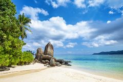 Tropical sandy beach with rock on Seychelles islands stock photo