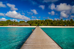 Beautiful tropical scenery, long jetty into the island Stock Photography