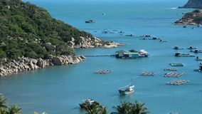 Beautiful tropical sea with fishing boats. In Doc Let, Khanh Hoa, Vietnam stock footage