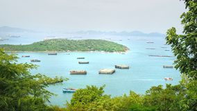Beautiful tropical sea with mountain, sky, cloud and general cargo ship at Chon Buri. stock photos