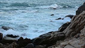 Beautiful tropical sea with rock and wave stock video footage