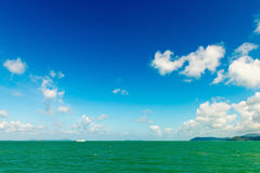 Beautiful tropical sea under the blue sky with green islands Stock Image