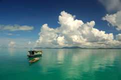 Beautiful tropical seascape. Beautiful seascape with water reflection and boat Stock Photo