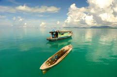 Beautiful tropical seascape. Beautiful seascape with water reflection and boat Stock Photos