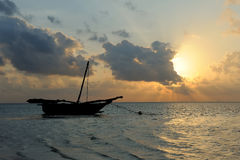 Beautiful tropical sunset with boat Stock Photos