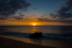 Beautiful tropical sunset at Kaanapali Beach in Maui Hawaii. Beautiful, warm tropical sunset on the white sands of Kaanapali Beach in Maui, Hawaii. A fabulous stock photos