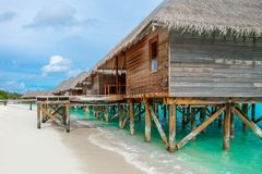 Wooden villas over water of the Indian Ocean. Beautiful tropical sunset landscape with wooden villas over water of the Indian Ocean, Maldives island Stock Photography